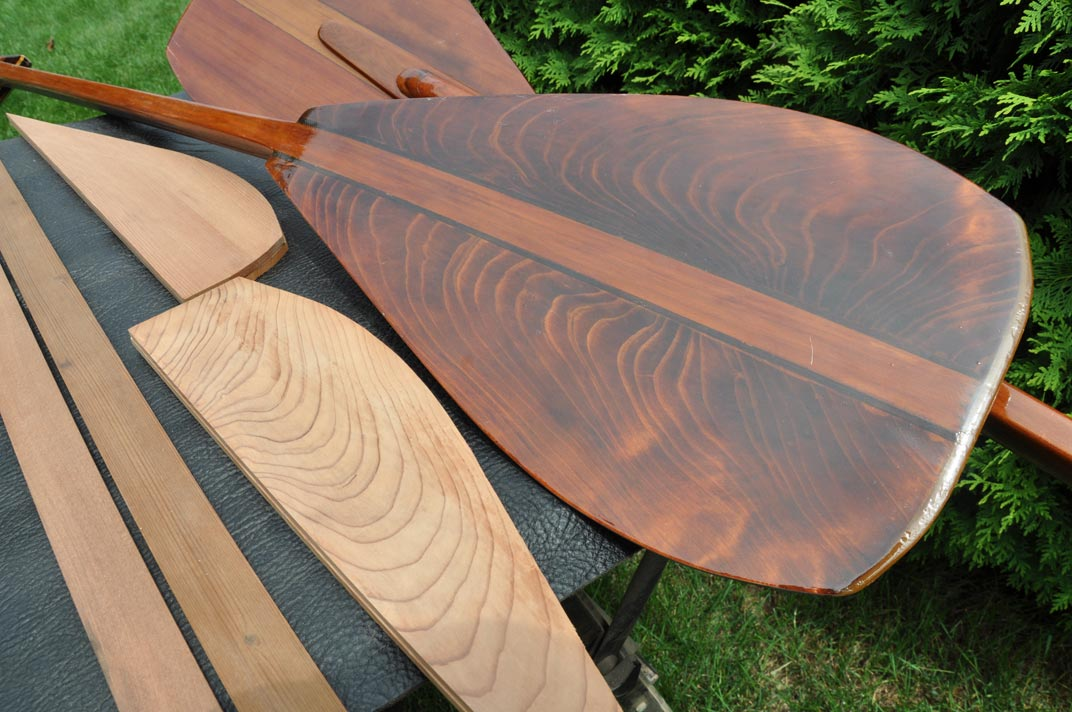 image of a redwood paddle pieces and a completed paddle